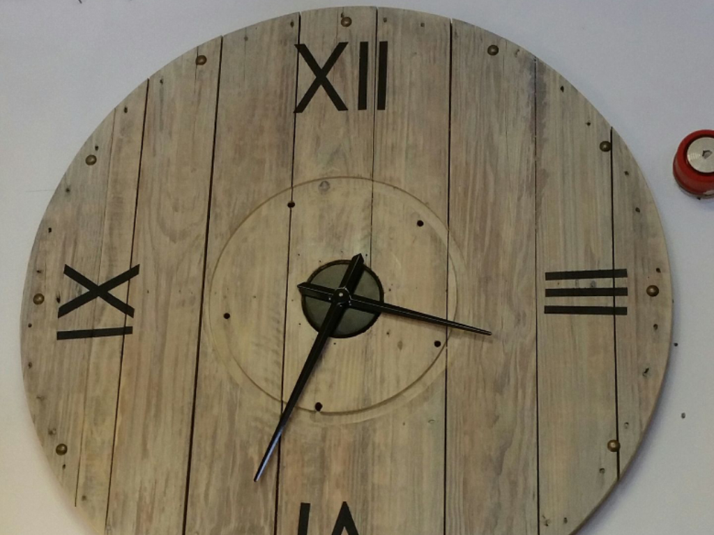 large clock built with reclaimed timber from Green Estate timber recycling shop