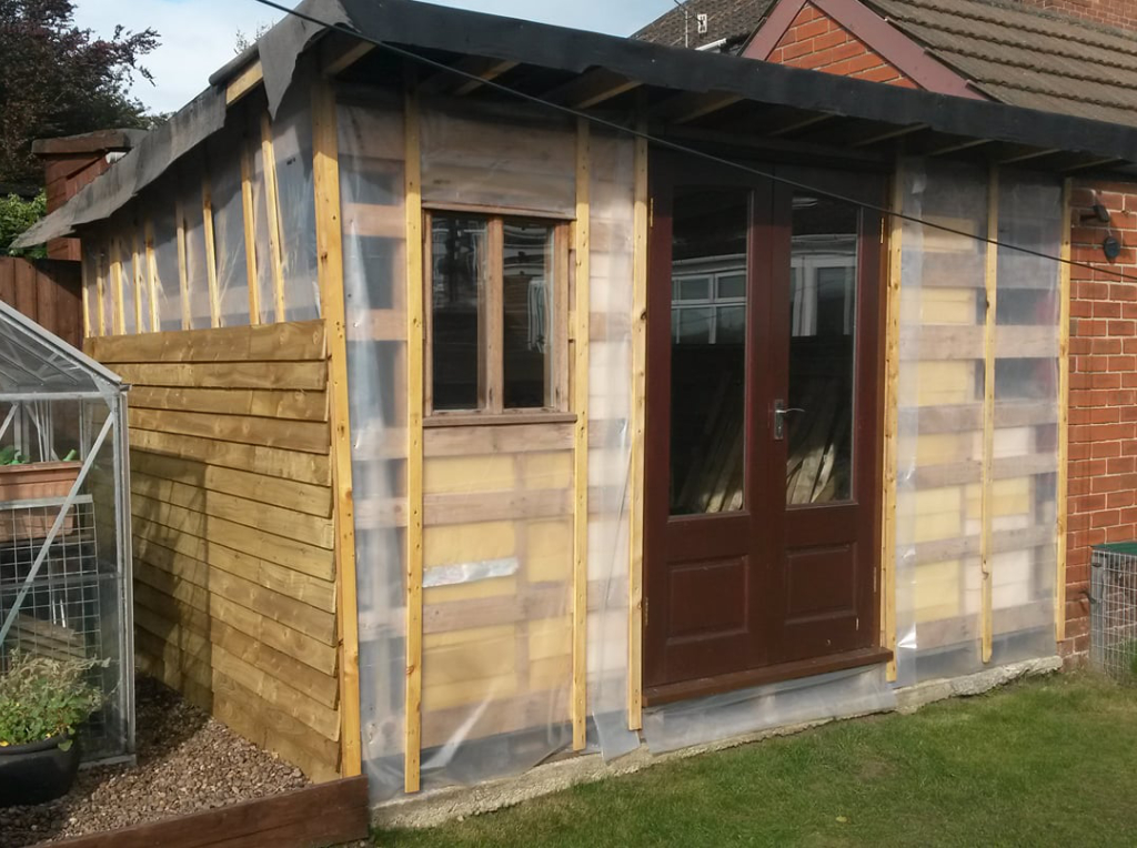 partially-built shed using reclaimed timber from Green Estate timber recycling shop